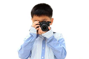 child (boy) holding a camera