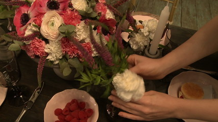 Cafe's worker decorates festive table with flowers