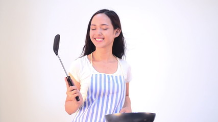 Asian woman cooking isolated