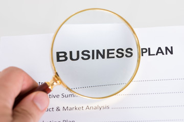 Magnifying glass and business plan