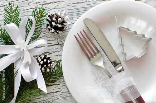 Leinwanddruck Bild Festive christmas dinner tableware with white plate