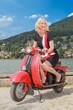 canvas print picture - Junge Frau auf einen Motorroller