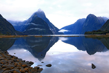 reflection of high mountain glacier at milford sound, New Zealan