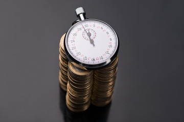 Stopwatch on stack of euro coins