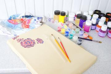 Batik process: artist paints on fabric, Batik painting