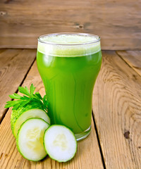 Juice cucumber in glass on board