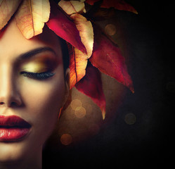 Autumn leaves hairstyle over dark background