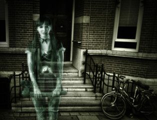 Scary woman ghost on porch of house