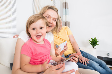 Mother and Kid Using Tablet Together