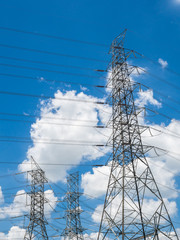 High voltage electricity posti with cloud and blue sky