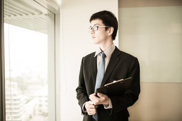 happy young business man work in modern office