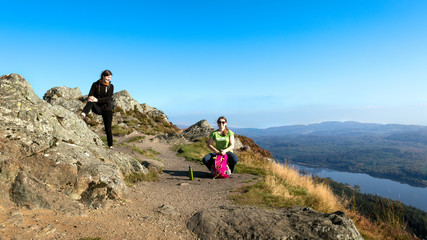 Female hikers on top of mountain taking a break, Scotland, UK
