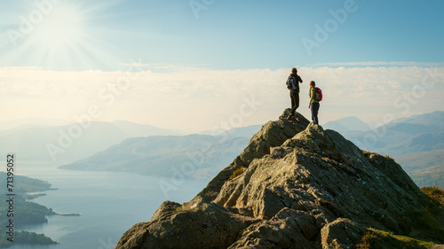 hikers on top of the mountain enjoying view, Highlands, Scotland - 71395052
