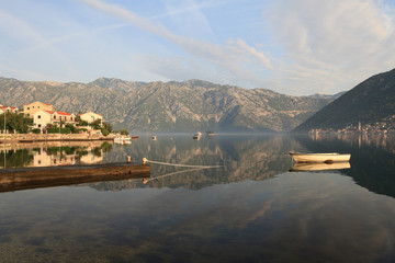 Morning in the Bay of Kotor. Boat and picturesque village