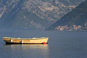 Beautiful yellow fishing boat in the morning