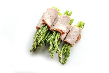 bacon wrapping asparagus on isolate
