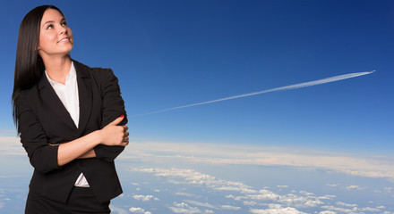 Businesswoman smiling and looking up