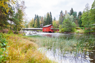 The idyllic landscape with red building