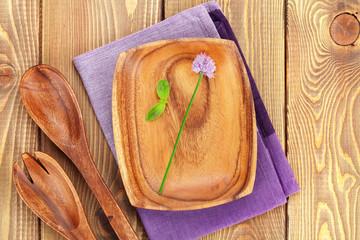 Wooden kitchen utensils and herbs