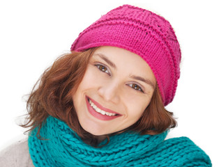Portrait of woman on white background with woolen accessories