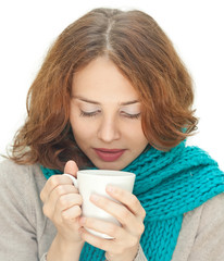 young woman in blue scarf with white mug isolated on white backg