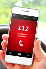 hand holding mobile phone 112 emergency number