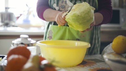 close up housewife hands woman washing salad in the home kitchen