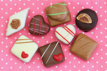 Selection of chocolates on pink background