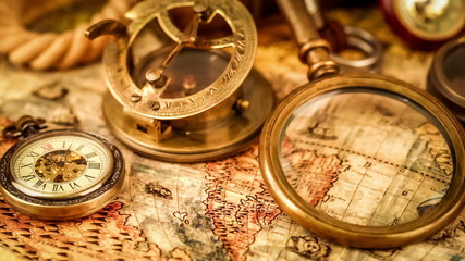 Vintage magnifying glass, compass, telescope and a pocket watch