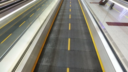 Airport moving sidewalk also travelator, walkalator and movator.