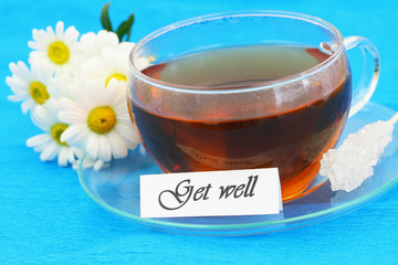 Get well card with cup of tea and white daisies