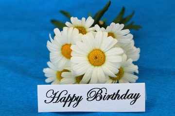 Happy Birthday card with white daisies on blue background
