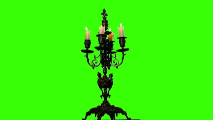 Candle in vintage candlestick on green screen