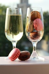 Two glasses of French macarons and champagne