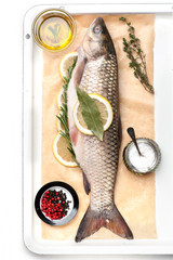 Raw fish carp with spices and herbs