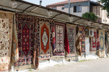 Colorful Handmade Carpets Displayed on the Street