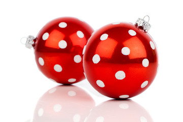 red polka dot Christmas bauble, isolated over white
