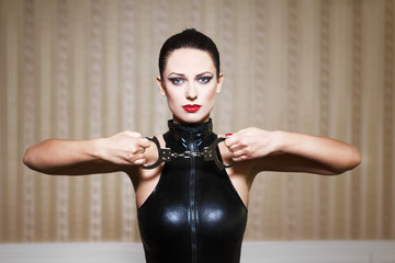 Sexy brunette woman bdsm