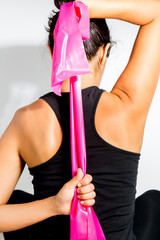 Woman doing exercise with resistance band and stretching