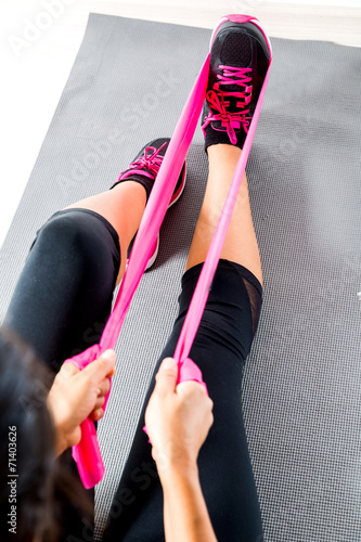 Tuinposter Gymnastiek Doing pilates with stretching bands