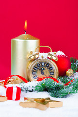 Christmas decorations - clock for the new year, candle, pine bra