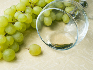 grapes and overturned glass