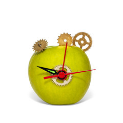 Isolated composition with apple and clockwork parts