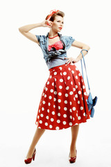 Pin-up young woman in vintage American style with a clutch