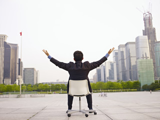 asian businessman celebrating success