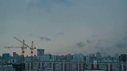 Sleeping quarters with construction cranes in Moscow