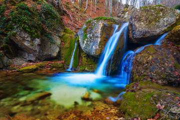 beautiful waterfall in a mountain canyon