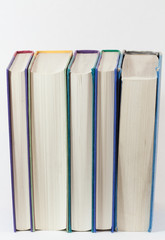 Books standing up vertical pages showing