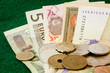 An up close shot of different currencies on green background