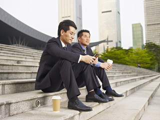 asian businesspeople talking outdoor